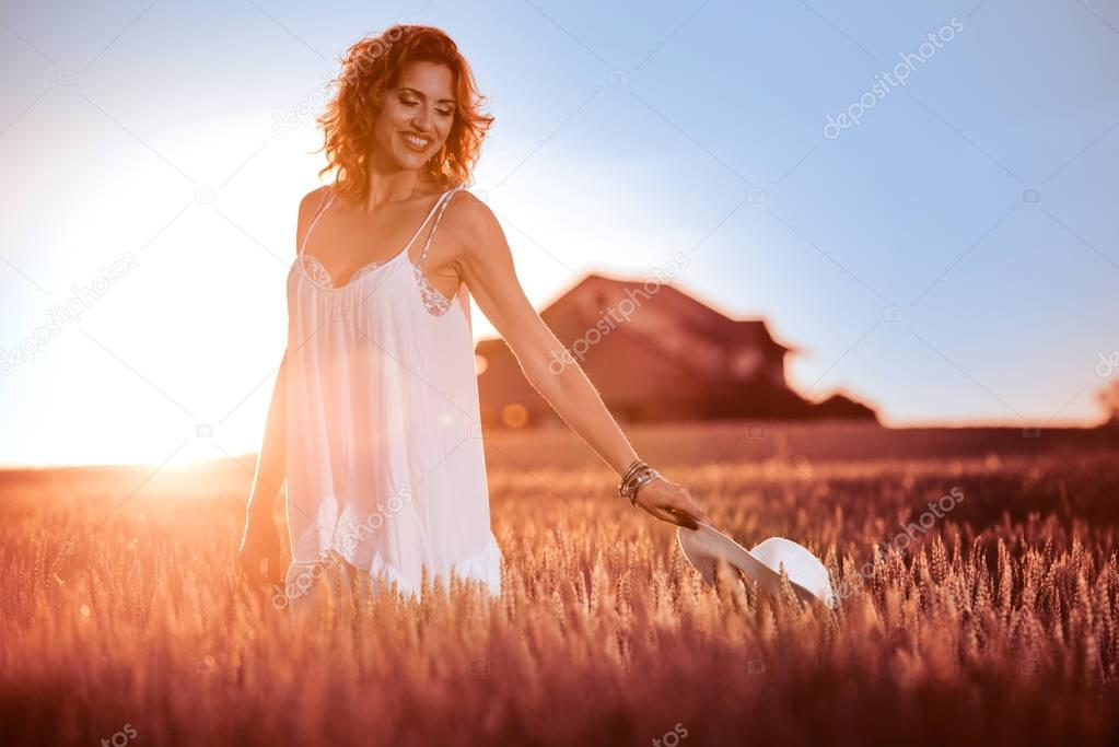 Free happy woman enjoying nature and freedom.Happy woman with hat.