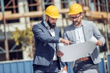 Two engineer have consulting meeting at construction site stock vector