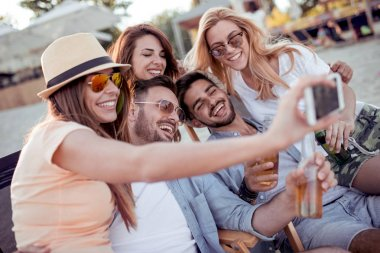 Group of friends taking selfie with smartphone on beach stock vector