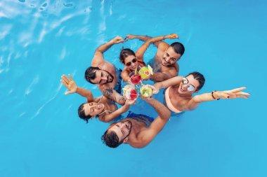 Group of friends have pool party