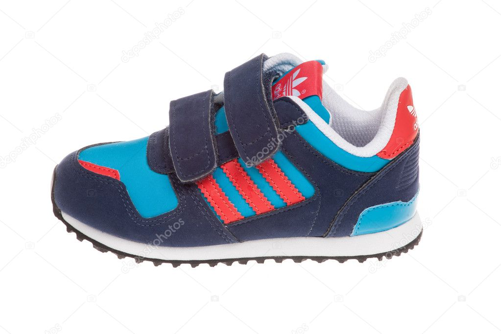 premium selection 974b5 dd7ba Varna , Bulgaria - APRIL 16, 2016  ADIDAS ORIGINALS ZX 700 CF children  shoe. Isolated on white. Product shot. Adidas is a German corporation that  ...