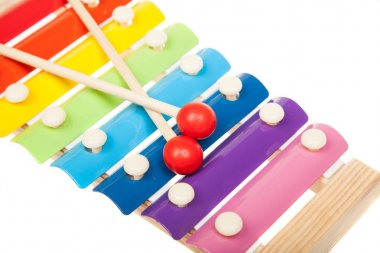 Rainbow colored toy xylophone, isolated on white