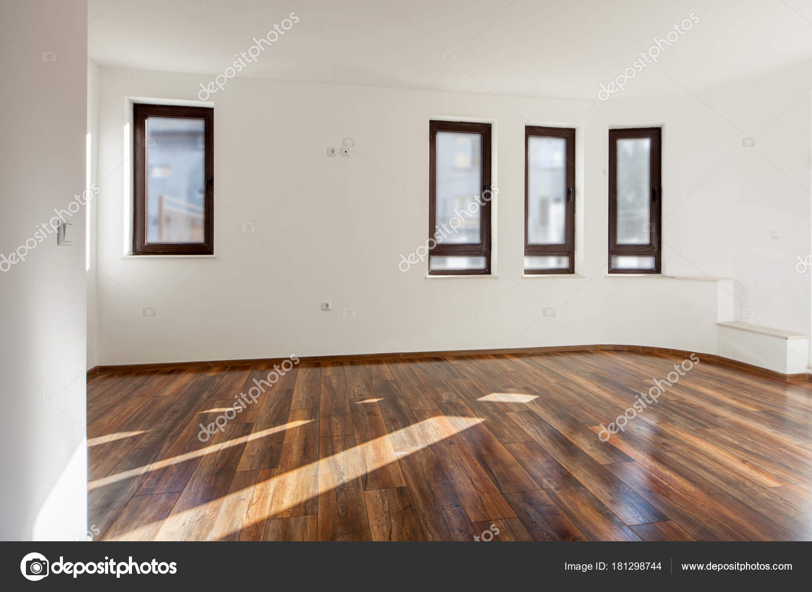 Empty room with natural light from windows modern house interior white walls wooden floor photo by dechevm