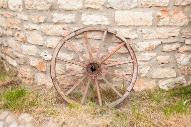 Old wagon wheel on the wall stock vector