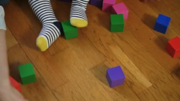 Baby girl playing blocks with her parents
