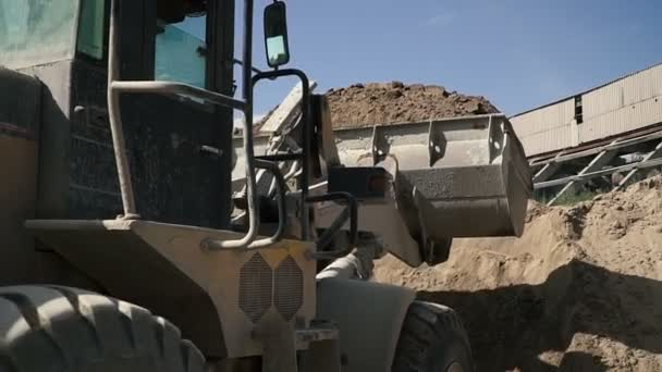 Tractor bucket  moving soil