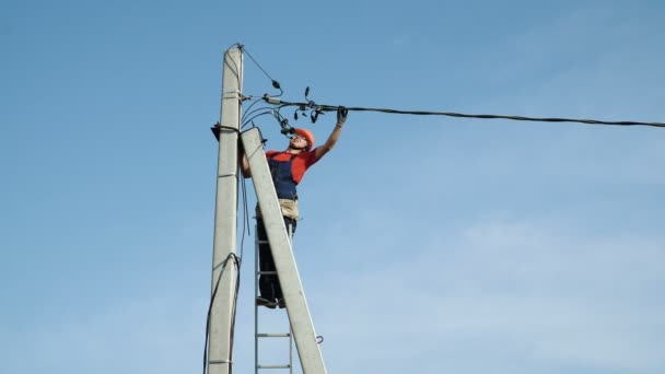 Electrician working at the power line