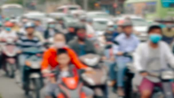 Unrecognisable anonymous crowd people driving defocused