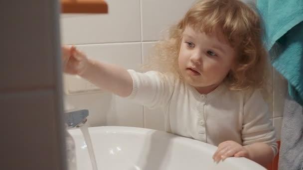 Naughty little girl in the bathroom