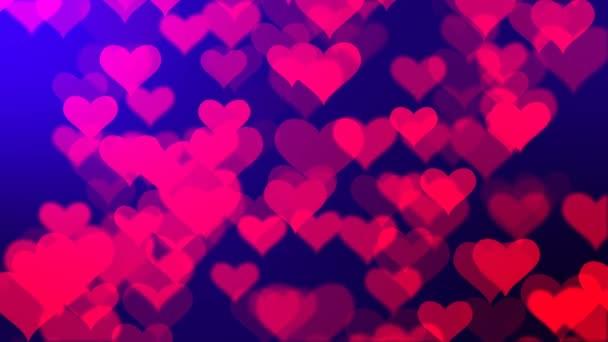 Srdce třpytící se částice pozadí. Abstraktní třpyt rozostřil modré pozadí. Bezproblémová animace smyčky.