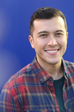 close-up portrait of handsome young man in plaid shirt