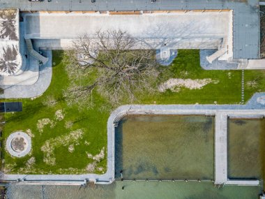 Aerial view of swimming baths on lakeside shore