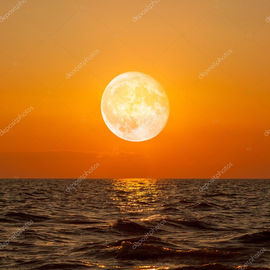 Full moon rising over empty ocean