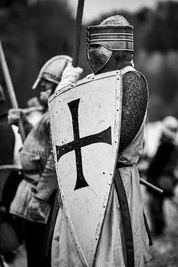 Knight in armor. Medieval battle (historical reconstruction)