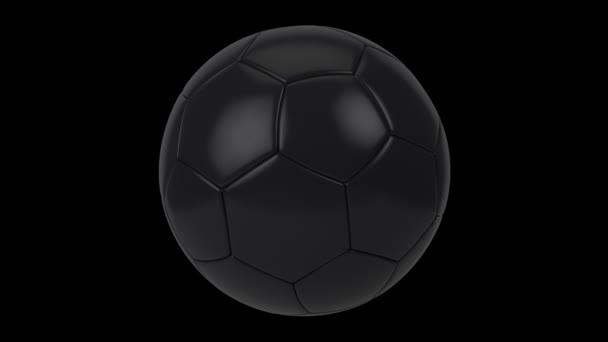 Realistický černý fotbalový míč izolovaný na černém pozadí. Animace 3D smyčky.