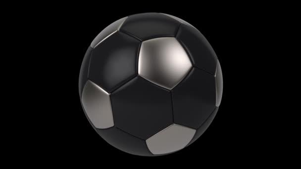 Realistické černé a železné fotbalové míče izolované na černém pozadí. Animace 3D smyčky.