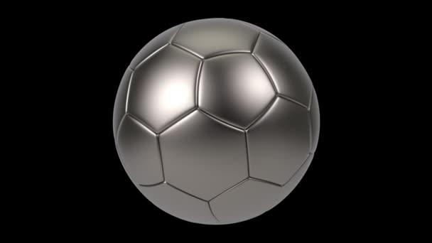 Realisztikus vas fém focilabda elszigetelt fekete háttérrel. 3D-s hurok animáció.