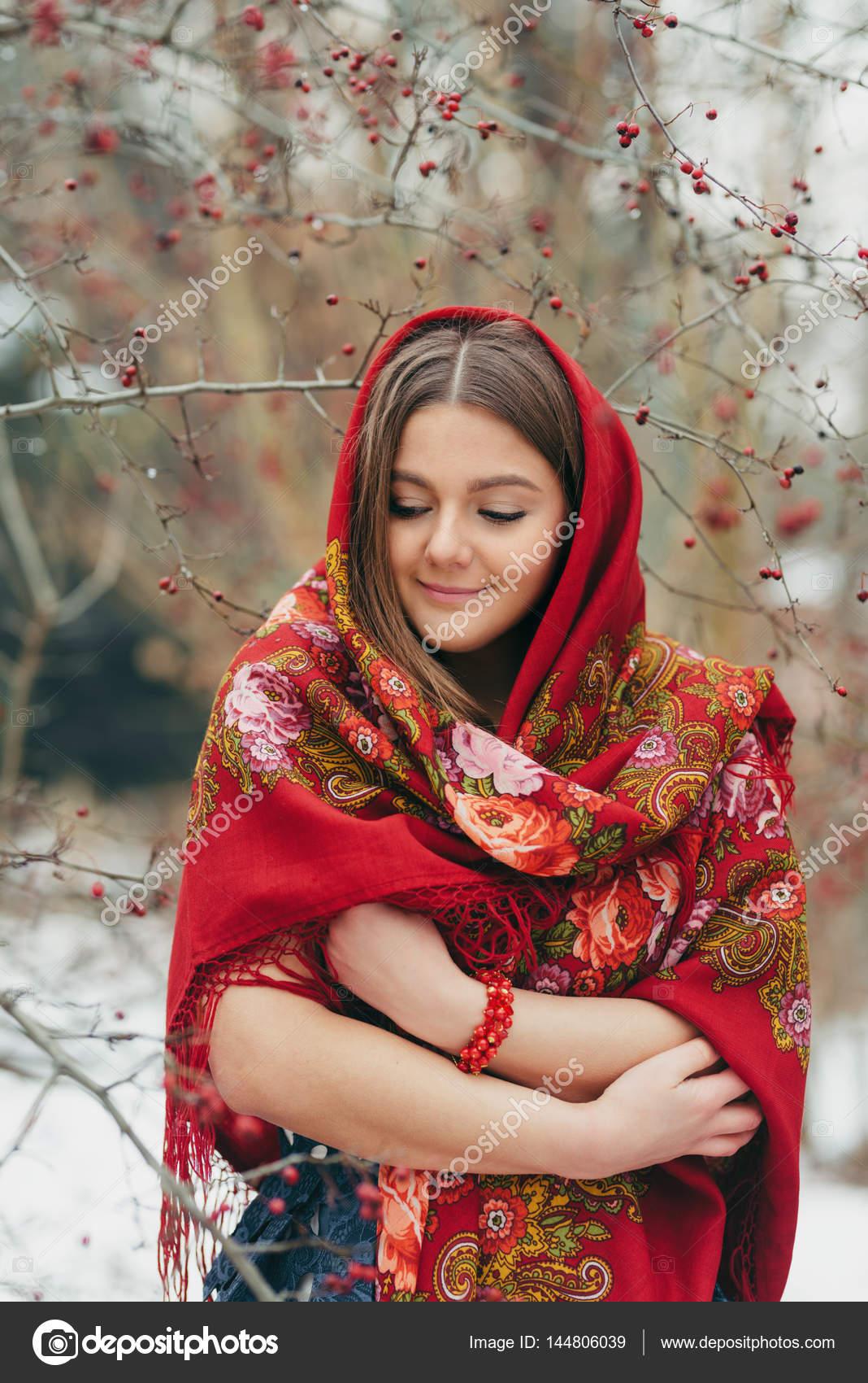 https://st3.depositphotos.com/3153157/14480/i/1600/depositphotos_144806039-stock-photo-beautiful-woman-in-russian-traditional.jpg