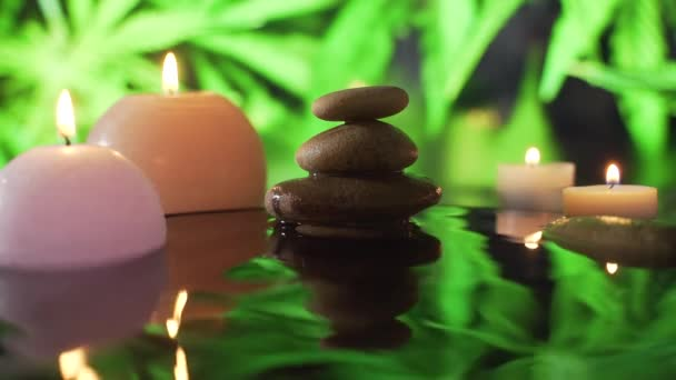 Spa Still Life, Stones massage and Water Relax. Close up. Relaxing view of burning candles. water reflection on blurred background.   Relaxation, meditation, peace and quiet.