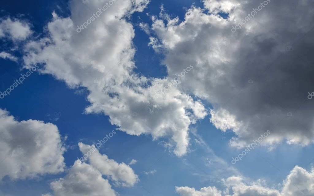 Blue sky background with white clouds. Texture of white clouds on blue sky