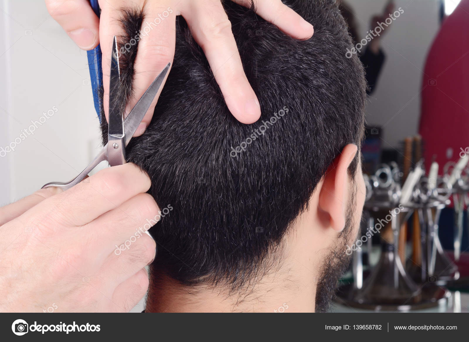 Young Man Having A Haircut With Scissors Stock Photo