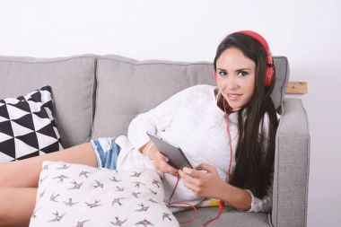 Woman listening music with tablet.
