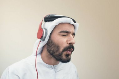 Arabian man in headphones