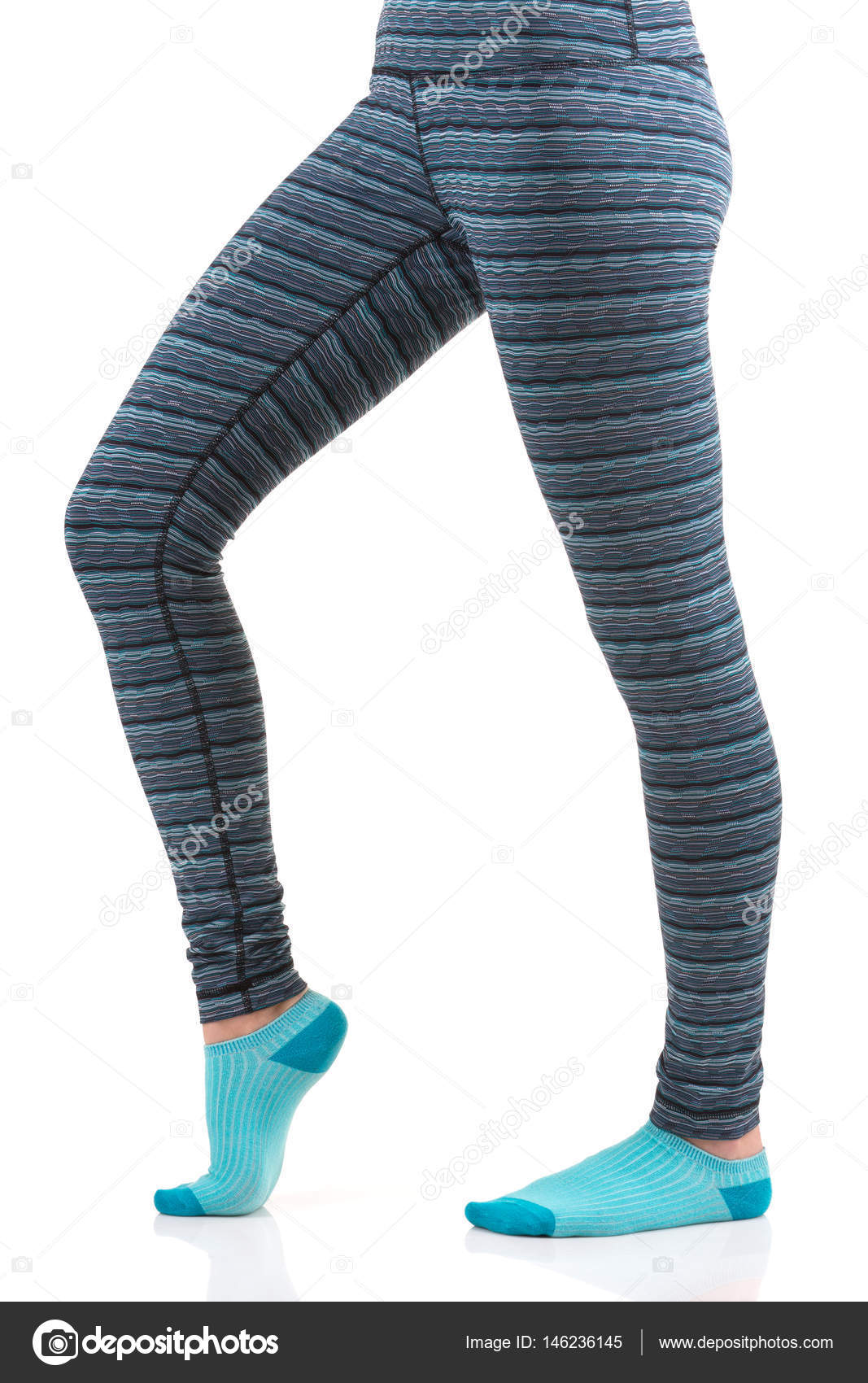 4ec9a2afbd484 Close up view of woman legs in colourful striped thermal pants and blue  socks from the ...
