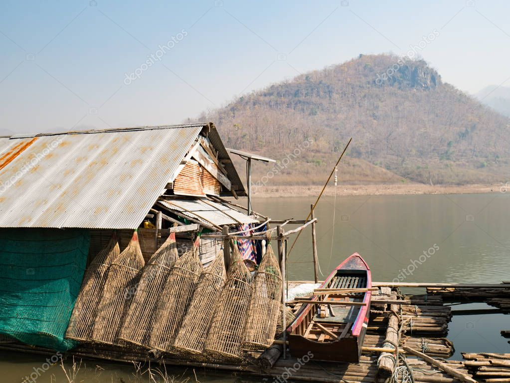 Houseboat and fish trap for fishing in summer