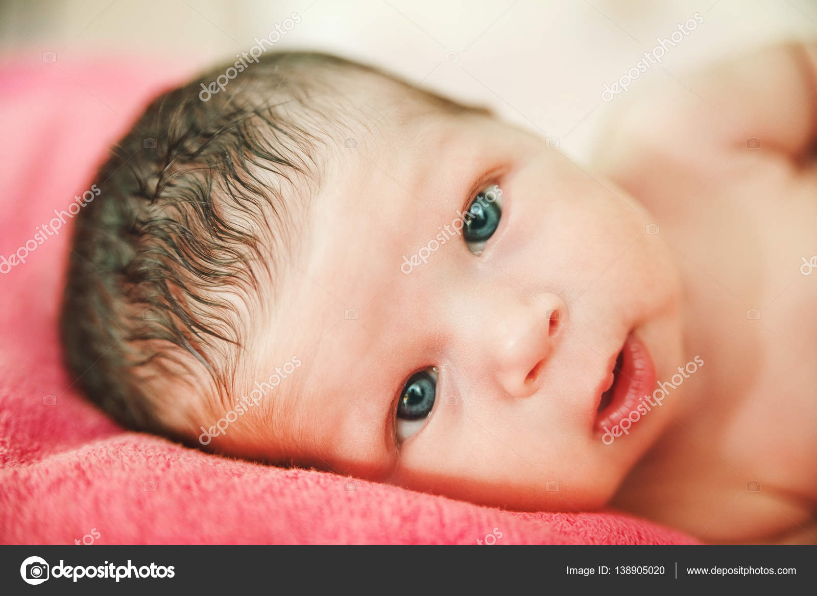 825f1678c Funny Face of Newborn Cute Baby Girl.Interesting Look.Selective ...