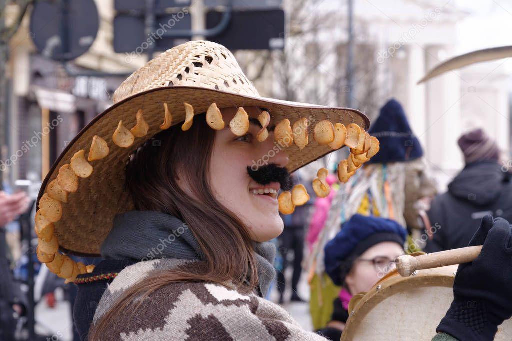 2017-02-25 Lithuania, Vilnius, Shrovetide, happy girl, dressed like a man, carnaval on Vilnius center. stock vector