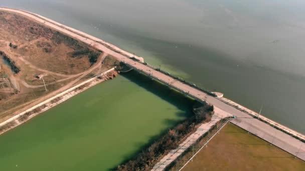 Aerial video - flying above a bridge named Old Bridge Dambovita between Dambovita RIver and Morii Lake , Bucharest, Romania.