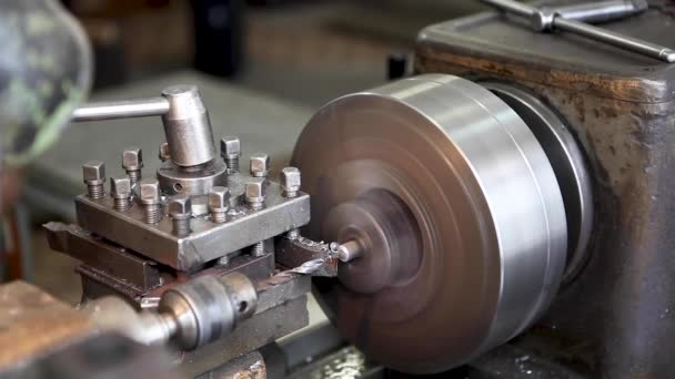 turning lathe in action, engine, turning, metal, machine, industry, steel, motor, equipment, power, technology, engineering, mechanical, industrial, lathe, gear, machinery, factory, old, repair, work, tool, workshop, production, manufacturing
