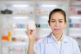 Fotografie Pharmacist and Doctor woman holding pill in hand , health care a