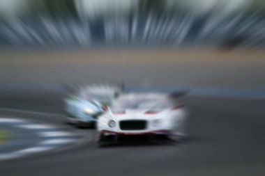 car racing on the road with motion blur and Radial blur in racin