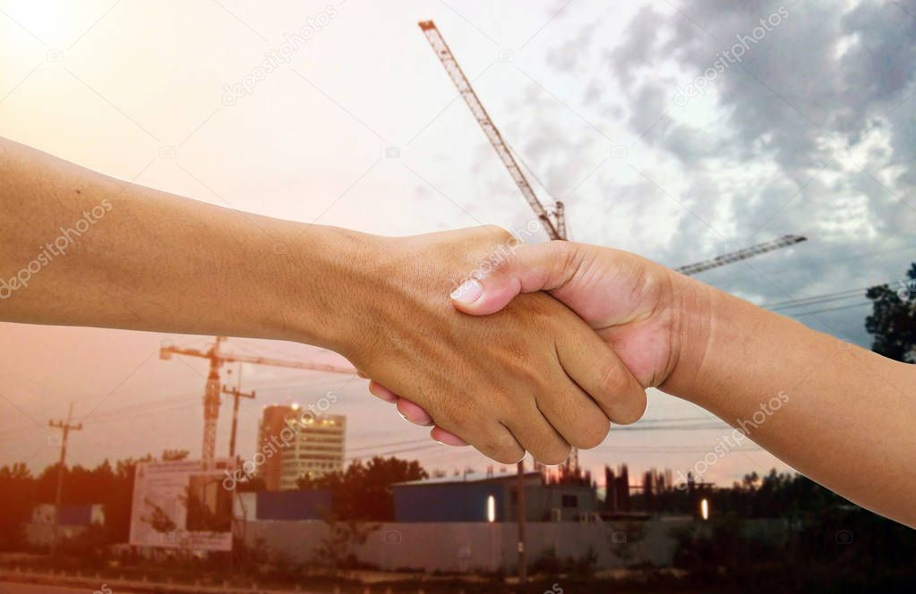 handshake in a business and deal at construction site