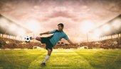 Fotografie Fotbal a fotbal hráče střílet fotbal na cíl na nohy