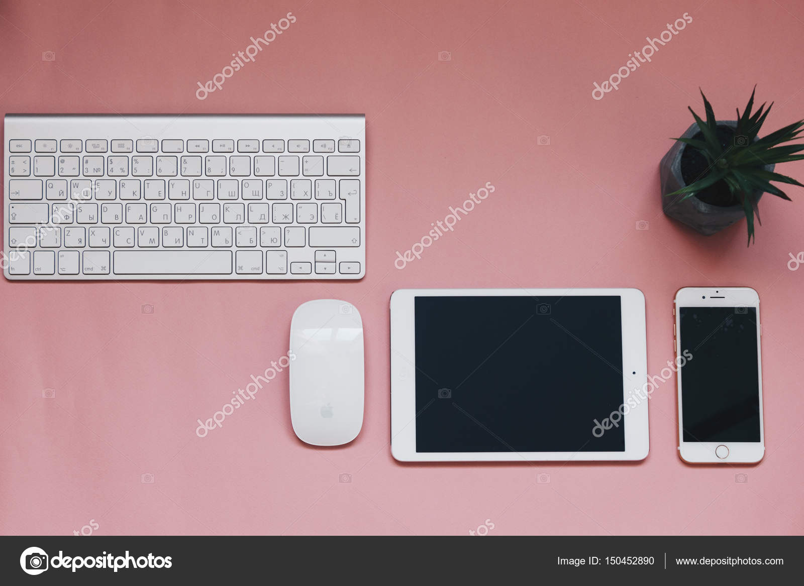 Top view of Apple keynote and PC mouse, iPad and iPhone 7