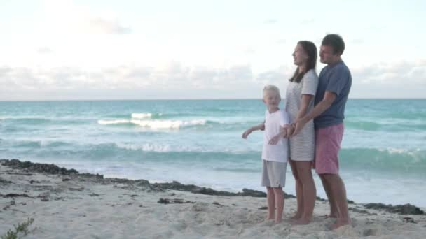 Romantic family with a child by the ocean