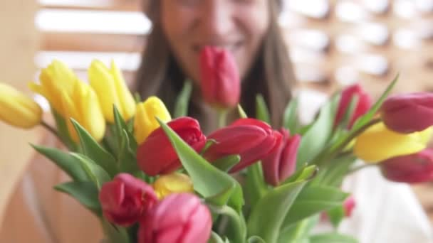 Happy Woman Stretches A Bouquet of Tulips