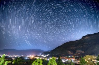 star trails over village