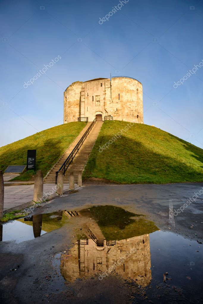 Cliffords Tower on green hill