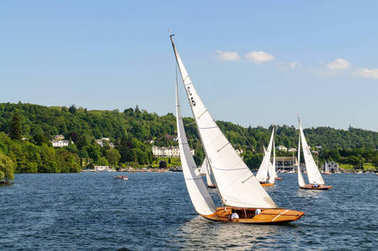 Power boating and water skiing activities on Windermere lake in Lake district, United Kingdom.