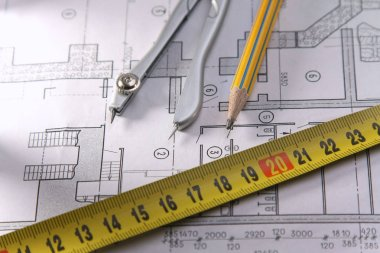 Architectural plans, compass and ruler on the desk