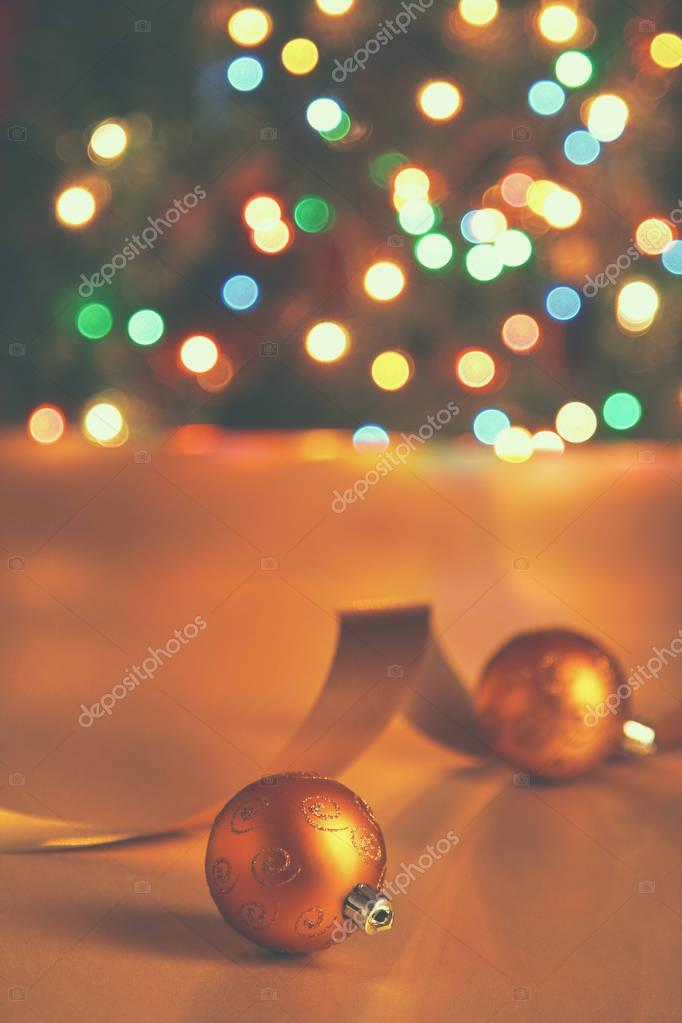 Gold balls with tape on a christmas background