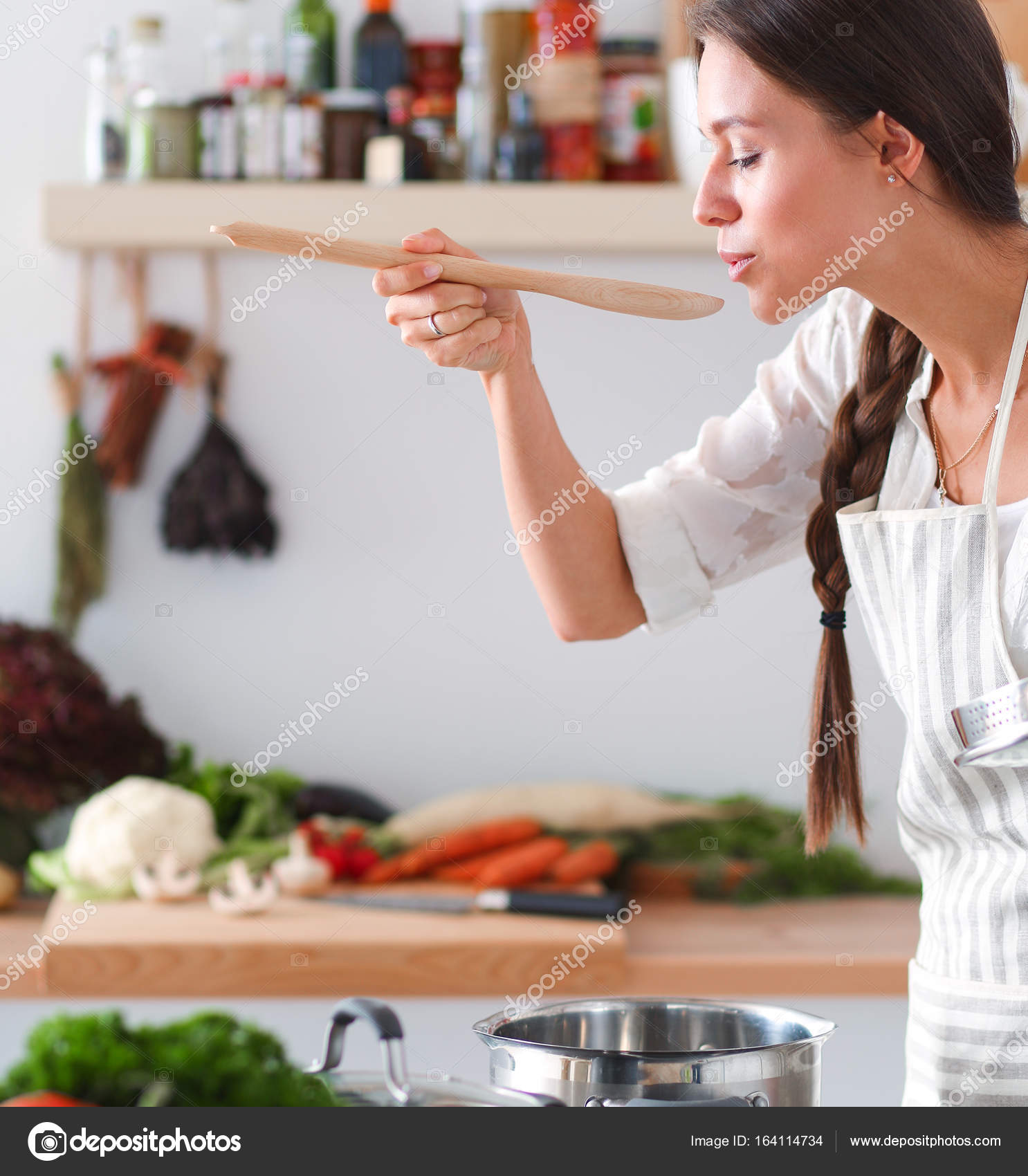 Cooking woman in kitchen with wooden spoon — Stock Photo ...