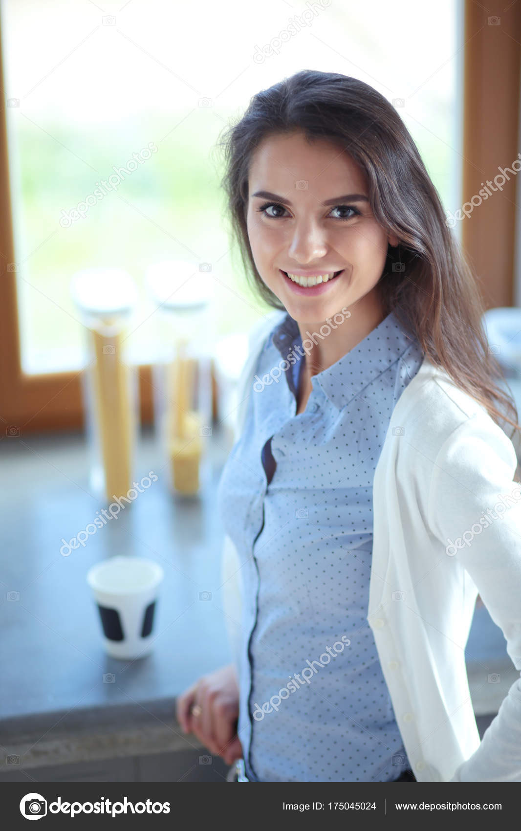 happy woman drinking tea in the kitchen at home. Woman at home ...