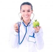 Fotografie Lékař ženu zkoumání apple s stetoskop. Lékaři ženě