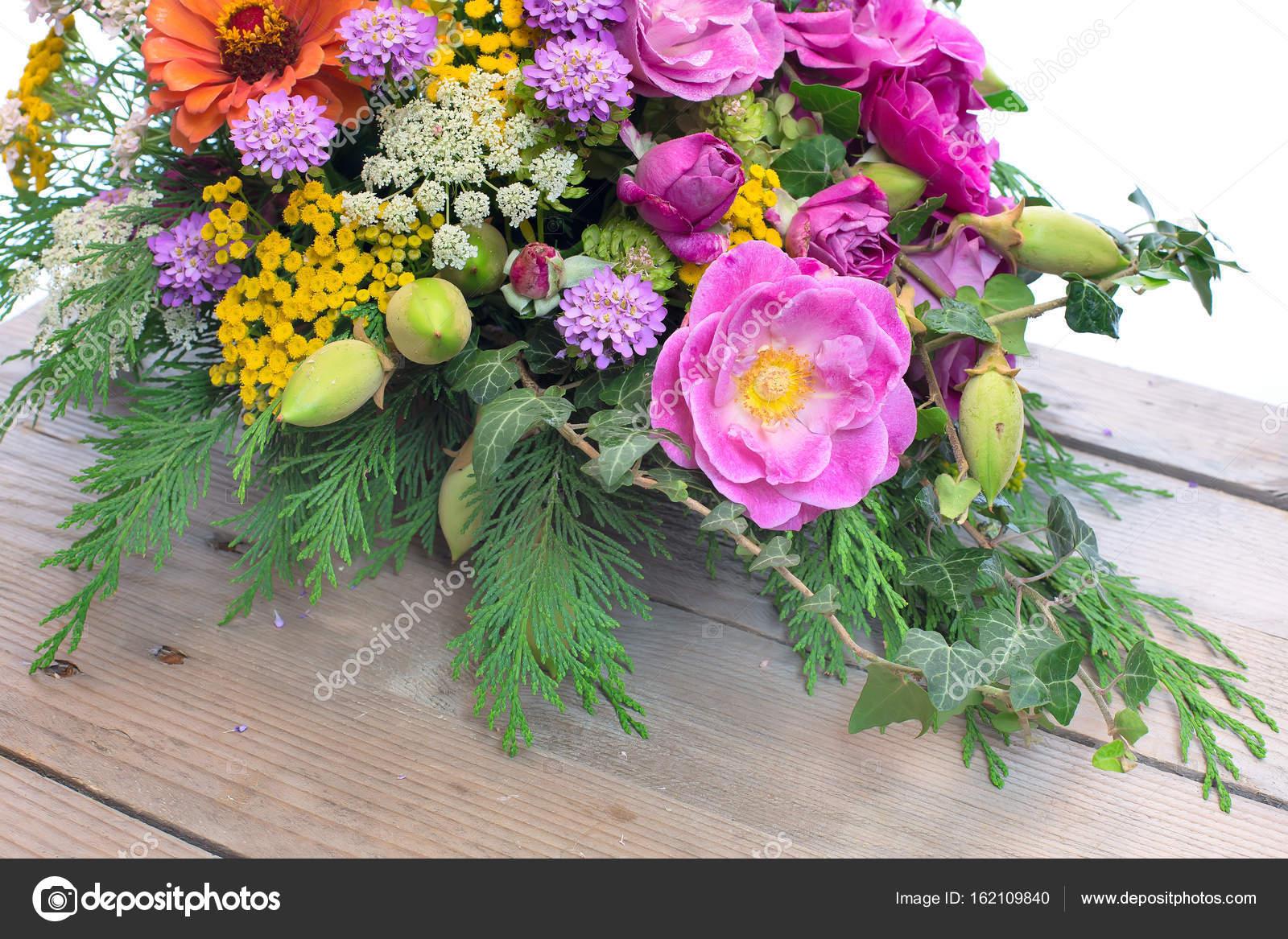 Bouquet of different flowers on wooden background stock photo bouquet bunch of fresh flowers on wooden background with white copy space photo by kisamarkiza izmirmasajfo