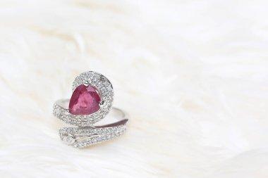 pink gemstone on diamond ring